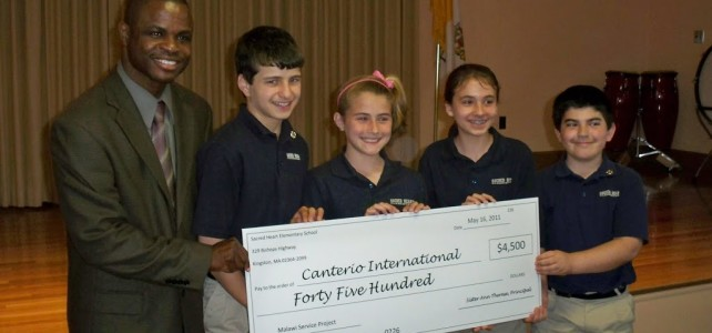 Sacred Heart Elementary School donation to Malawi Orphans
